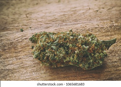 Super Lemon Haze strain of cannabis sativa marijuana on a wooden surface.