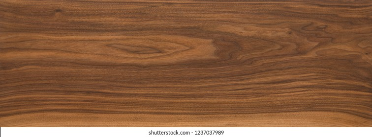 Super long walnut planks texture background.Dark tone walnut texture,Walnut natural texture, texture elements.