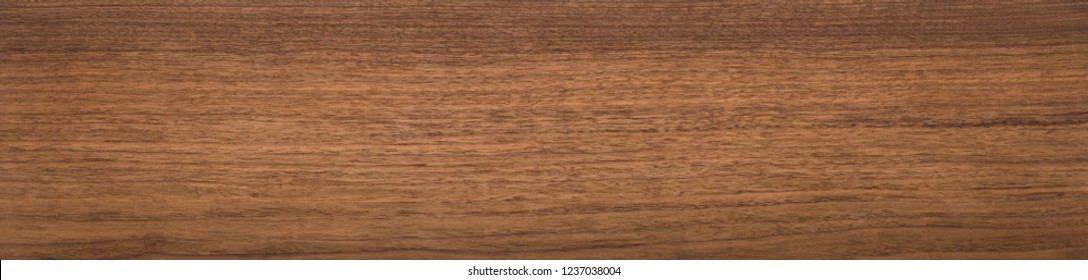 Super long walnut planks texture background.Walnut natural texture.