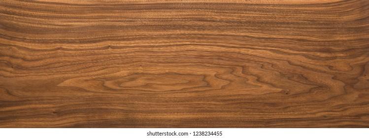 Super long walnut planks texture background.Walnut natural texture.