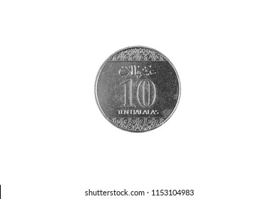 A super macro image of a Saudi Arabian 10 halalas coin isolated on a white background