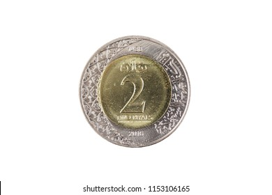 A super macro image of a two saudi riyal coin isolated on a white background