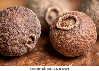 super macro shot of allspice dry pepper in detail very close. food spice background