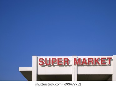 super market sign on the top of the edifice