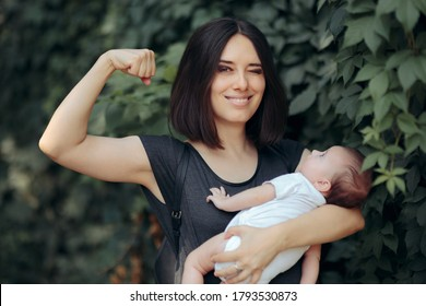 Super Mom in Strong Powerful Pose Holding Newborn. Super heroine mother being a role mother to her daughter