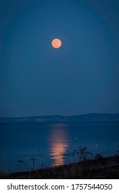 Super moon called the Pink Moon was the largest supermoon of 2020 rising over Protection Island, Strait of Juan de Fuca, WA, USA