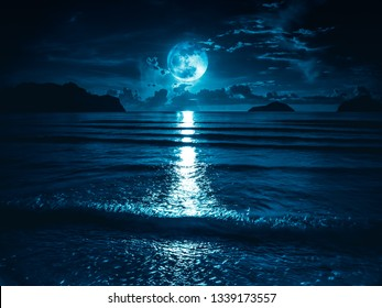 Super moon. Colorful sky with bright full moon over seascape. Serenity nature background, outdoor at gloaming. The moon taken with my own camera.