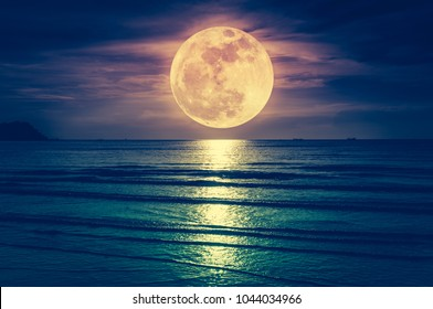 Super moon. Colorful sky with cloud and bright full moon over seascape in the evening. Serenity nature background, outdoor at nighttime. Cross process. The moon taken with my own camera.