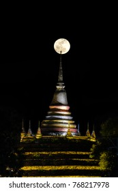 Super moon in night sky and silhouette of ancient pagoda is named Wat Ratchaburana, Phitsanulok in Thailand