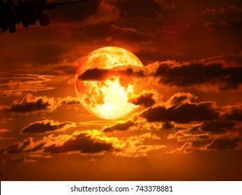 super moon on silhouette cloud in red tone sky, Elements of this image furnished by NASA