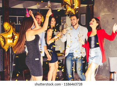 Super party with best friends. A company of very positive friends have fun at a party. Young group of happy friends celebrating birthday