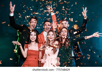 Super party with best friends. A company of very positive friends have fun in confetti at a party.