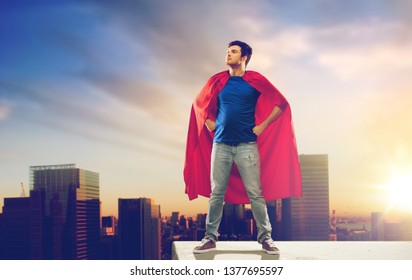 super power and people concept - happy young man in red superhero cape over sunset in tokyo city background