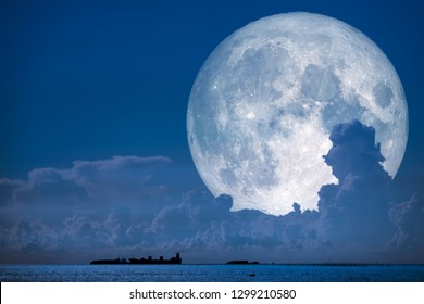super snow moon back on night sky silhouette cloudon sea, Elements of this image furnished by NASA