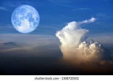 super snow moon back white heap cloud on blue sky, Elements of this image furnished by NASA