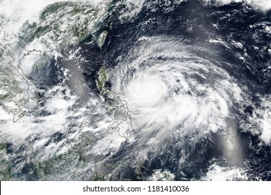 Super Typhoon Mangkhut (known locally as Ompong) Bearing Down on The Philippines. Elements of this image furnished by NASA