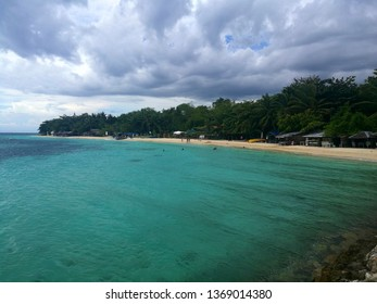Super Typhoon Mangkhut is touching the stunning Lambug White Sand Beach and the turquoise ocean in Moalboal, Cebu, Philippines