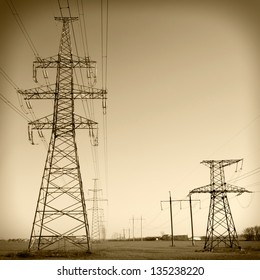 Super wide angle photograph of a row of power lines against a blue sky. Vintage