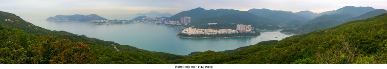 Super wide panorama of Tai Tam Bay and Red Hill in Hong Kong, as seen from Dragon's Back hiking trail