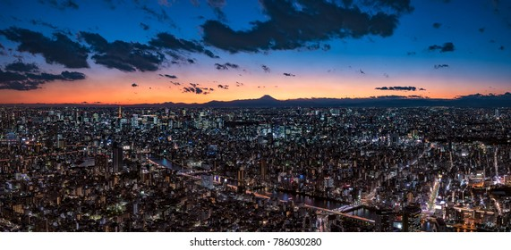 Super Wide Panorama Tokyo Cityscape at dusk with Mount Fuji silhouette