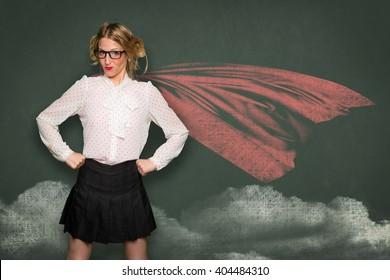 Super woman nerd geek teacher student in blackboard drawing cape successful confident powerful