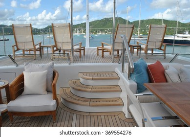 Super Yacht Aft Deck with Lounge Chairs and View of Antigua Harbor, Caribbean