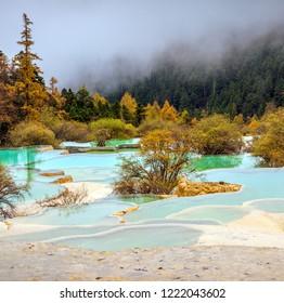 Superb colorful ponds in Huanglong National Park near Jiuzhaijou - SiChuan, China