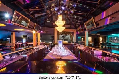 Superb luxury chandelier above bar in discotheque interior