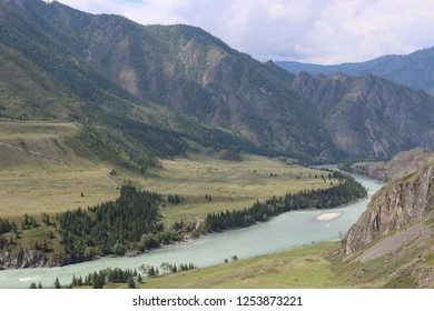 "Superb mountain landscape with the turquoise river ""Katun"". Wonderful view from the top of the mountain. Russia, mountain Altai. Atmospheric juicy summer and Russian nature"