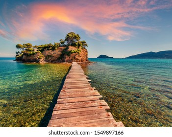 Superb summer sunrise on Port Sostis, Zakinthos island, Greece, Europe.  Wooden footbridge to Cameo Island. Beauty of nature concept background.