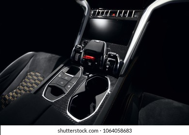 Supercar carbon dashboard interior in dark with start and stop button and glass holder lamborghini hypercar style