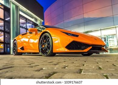 Supercar Lamborghini Huracan orange color parked at the car dealership. Russia, Saint-Petersburg. 02 March 2018.