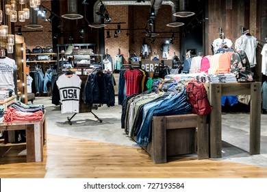 Superdry shop at Emquatier, Bangkok, Thailand, Sep 2, 2017 : Luxury and fashionable brand window display. New collection of sportswear display at flagship store.