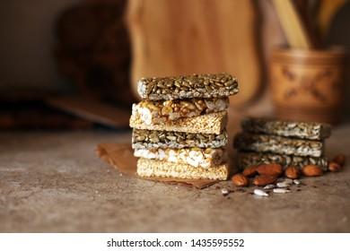 Superfood breakfast bars Nuts raw set almond on texture background nutrition organic vegan food concept. Vegeterian diet