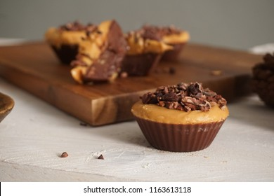 Superfood Cacao Carob Peanut Butter Cups topped with Cacao nibs.