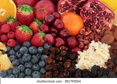 Superfood fruit selection forming a background, high in antioxidants, vitamins and dietary fibre background.