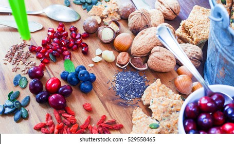 Superfood: variation of superfoods breakfast on wooden table background