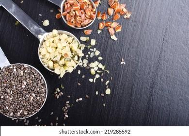 Superfoods. Chia seeds, hemp seeds and broken flax seeds in measuring spoons