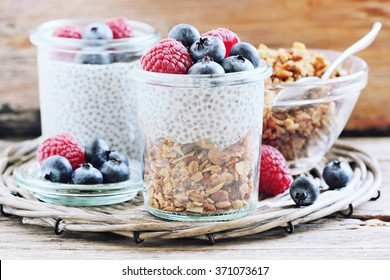 Superfoods concept : overnight chia pudding with homemade granola,fresh berries and honey. Healthy eating. Selective focus.