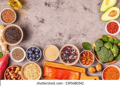 Superfoods on gray concrete background. Healthy food clean eating concept. Top view.