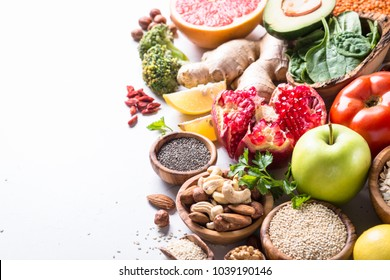 Superfoods on white background. Healthy vegan nutrition.