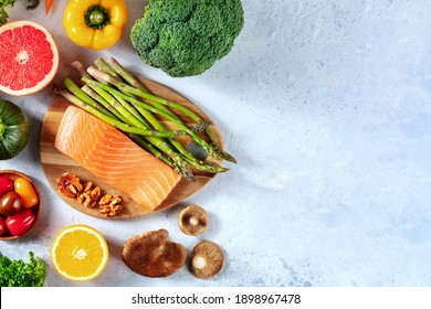Superfoods, shot from the top with a place for text. Salmon, asparagus, mushrooms, broccoli