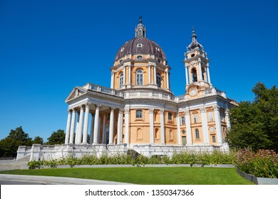 Superga basilica on Turin hills with flowerbed and clear blue sky in a sunny summer day in Italy
