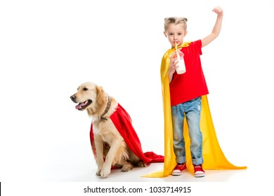 Supergirl drinking milkshake and gesturing with dog in red cape beside isolated on white