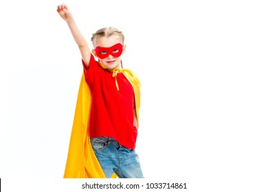 Supergirl wearing yellow cape and red mask for eyes gesturing by hand isolated on white