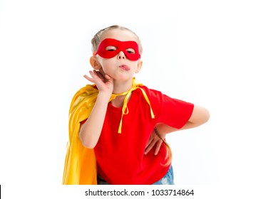 Supergirl wearing yellow cape and red mask for eyes showing tongue isolated on white