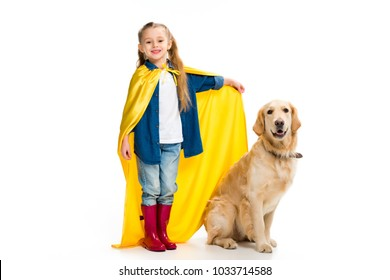 Supergirl in yellow cape standing with golden retriever  beside isolated on white