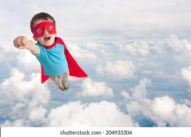 superhero boy child flying mid air above cloud level