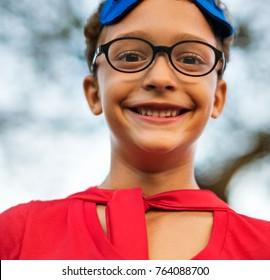 Superhero boy with glasses