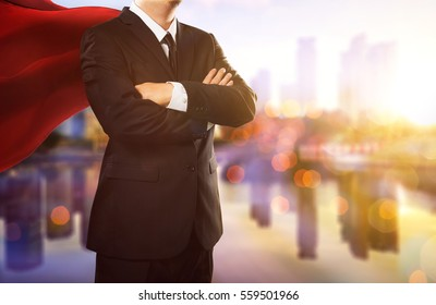 superhero businessman, city skyline background . the concept of success, leadership and victory in business.